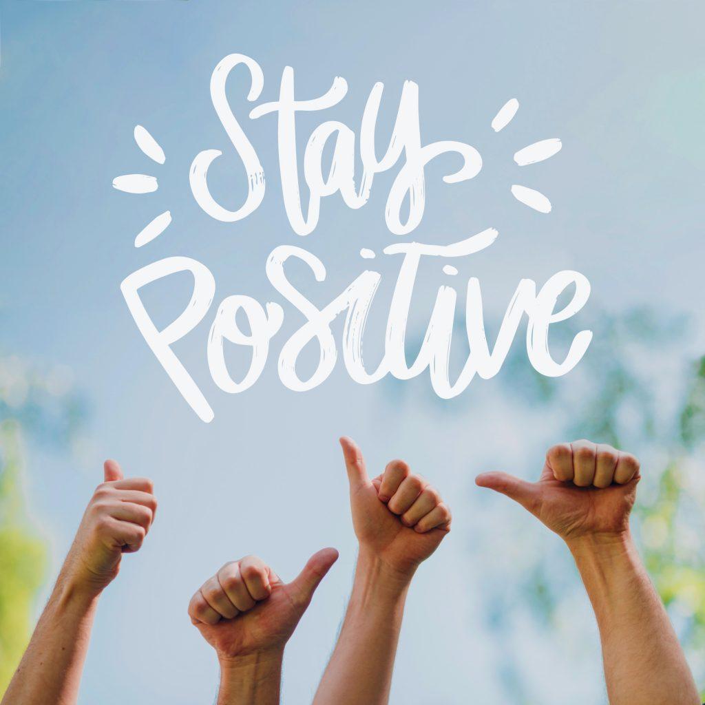 Stay Positive in tijden van corona. Duimen omhoog.